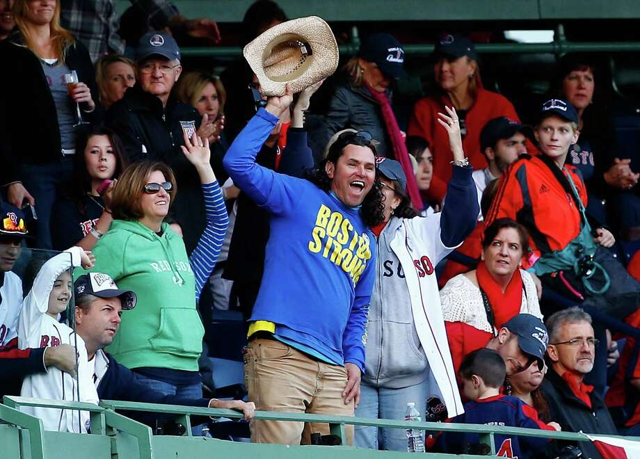 BOSTON, MA - NOVEMBER 02: Carlos Arredondo cheers during the World Series victory parade at Fenway Park on November 2, 2013 in Boston, Massachusetts. Photo: Jared Wickerham, Getty Images / Getty Images