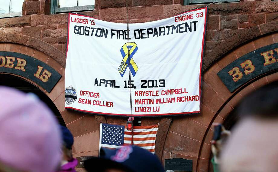 BOSTON, MA - NOVEMBER 02: A banner hangs at Ladder 15 on Boylston Street in honor of the Boston Marathon bombing victims during the World Series victory parade on November 2, 2013 in Boston, Massachusetts. Photo: Jared Wickerham, Getty Images / Getty Images
