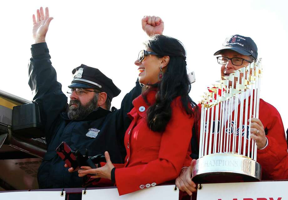 BOSTON, MA - NOVEMBER 02:  Boston Red Sox owner John Henry holds up the World Series trophy next to Boston Police officer Steve Horgan during the World Series victory parade on November 2, 2013 in Boston, Massachusetts. Photo: Jared Wickerham, Getty Images / Getty Images