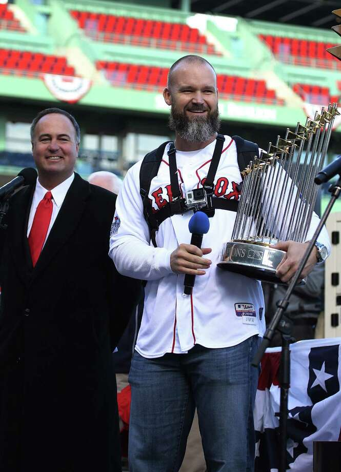 BOSTON, MA - NOVEMBER 2:  David Ross of the Boston Red Sox addresses the crowd at Fenway Park before the Red Sox players board the duck boats for the World Series victory parade for the Boston Red Sox on November 2, 2013 in Boston, Massachusetts. Photo: Gail Oskin, Getty Images / Getty Images
