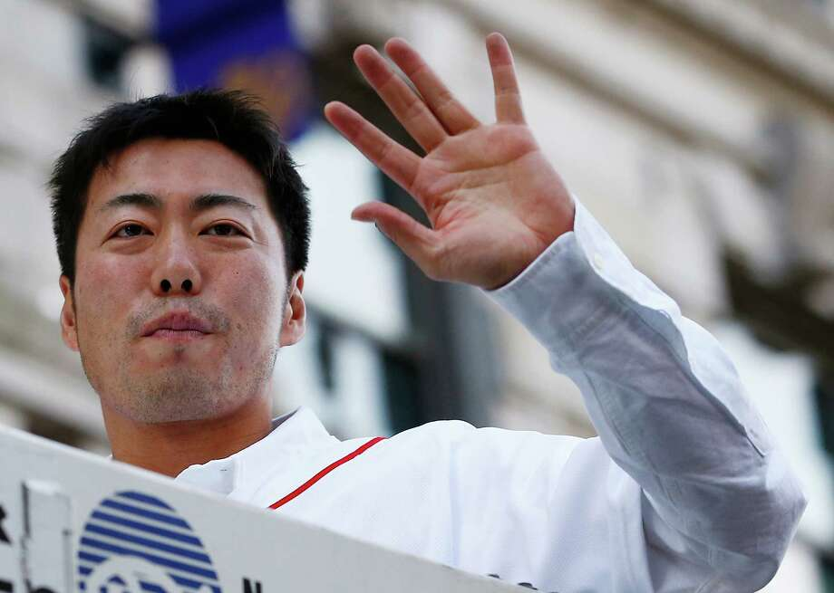 BOSTON, MA - NOVEMBER 02:  Koji Uehara #19 of the Boston Red Sox waves to the crowd during the World Series victory parade on November 2, 2013 in Boston, Massachusetts. Photo: Jared Wickerham, Getty Images / Getty Images