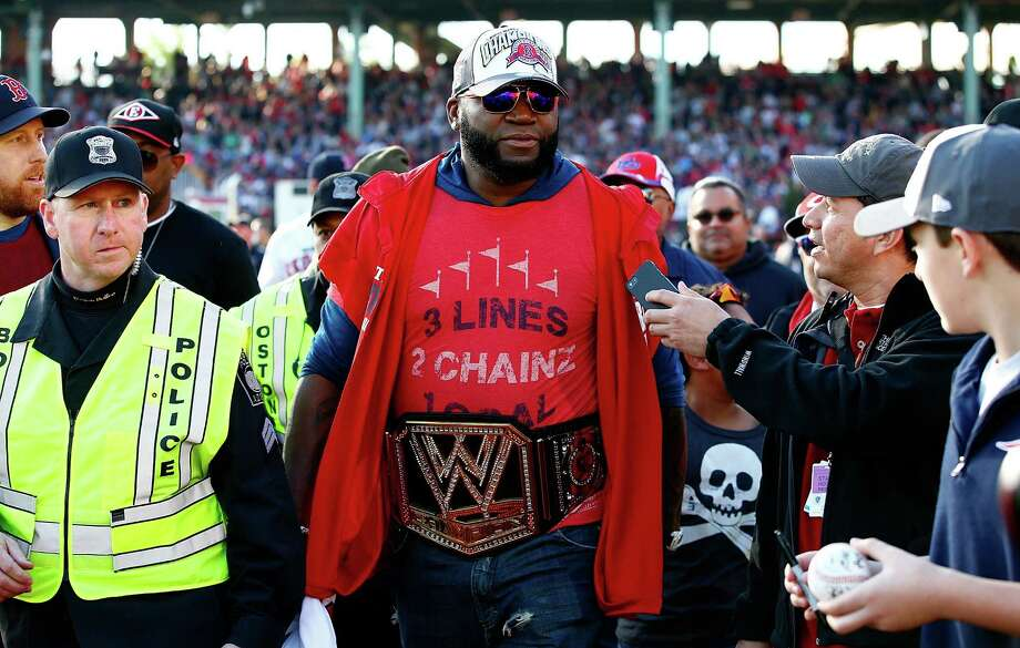 BOSTON, MA - NOVEMBER 02: David Ortiz #34 of the Boston Red Sox walks to his float while wearing a wrestling belt during the World Series victory parade at Fenway Park on November 2, 2013 in Boston, Massachusetts. Photo: Jared Wickerham, Getty Images / Getty Images
