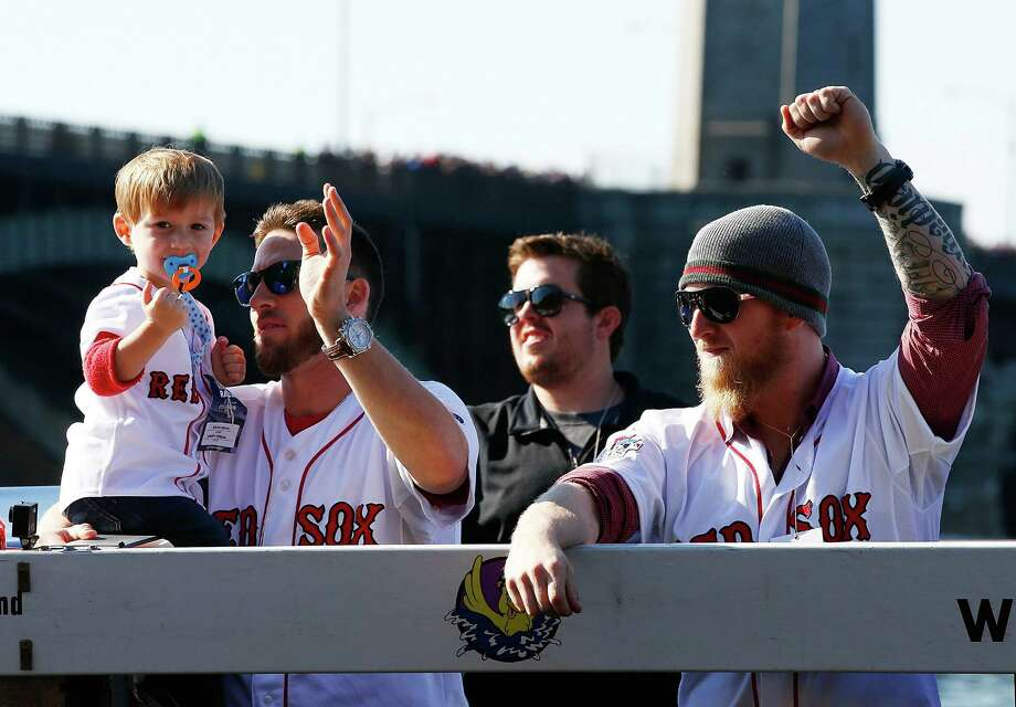 BOSTON, MA - NOVEMBER 02: Stephen Drew #7 and Mike Carp #37 of the Boston Red Sox celebrate on the Charles River during the World Series victory parade on November 2, 2013 in Boston, Massachusetts. Photo: Jared Wickerham, Getty Images / Getty Images