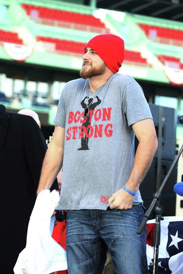 BOSTON, MA - NOVEMBER 2:  Will Middlebrooks of the Boston Red Sox address the crowd at Fenway Park before the Red Sox players board the duck boats for the World Series victory parade for the Boston Red Sox on November 2, 2013 in Boston, Massachusetts. Photo: Gail Oskin, Getty Images / Getty Images