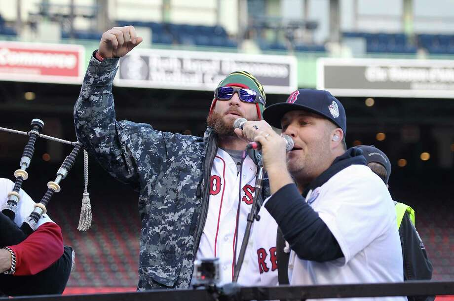 BOSTON, MA - NOVEMBER 2:  Jonny Gomes (L) and Ken Casey of the Drop Kick Murphys perform for the crowd before the Red Sox players board the duck boats for the World Series victory parade for the Boston Red Sox on November 2, 2013 in Boston, Massachusetts. Photo: Gail Oskin, Getty Images / Getty Images