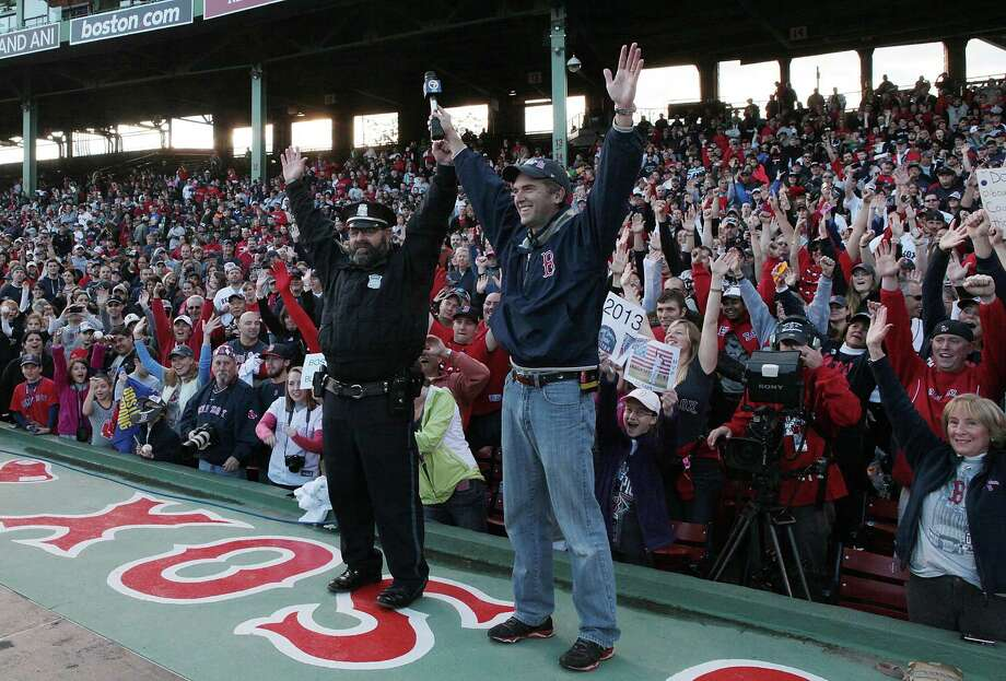 BOSTON, MA - NOVEMBER 2:  Boston Police Officer Steve Horgan, known as the Boston Red Sox bullpen cop cheers along with the fans  at Fenway Park before the Red Sox players board the duck boats for the World Series victory parade for the Boston Red Sox on November 2, 2013 in Boston, Massachusetts. Photo: Gail Oskin, Getty Images / Getty Images