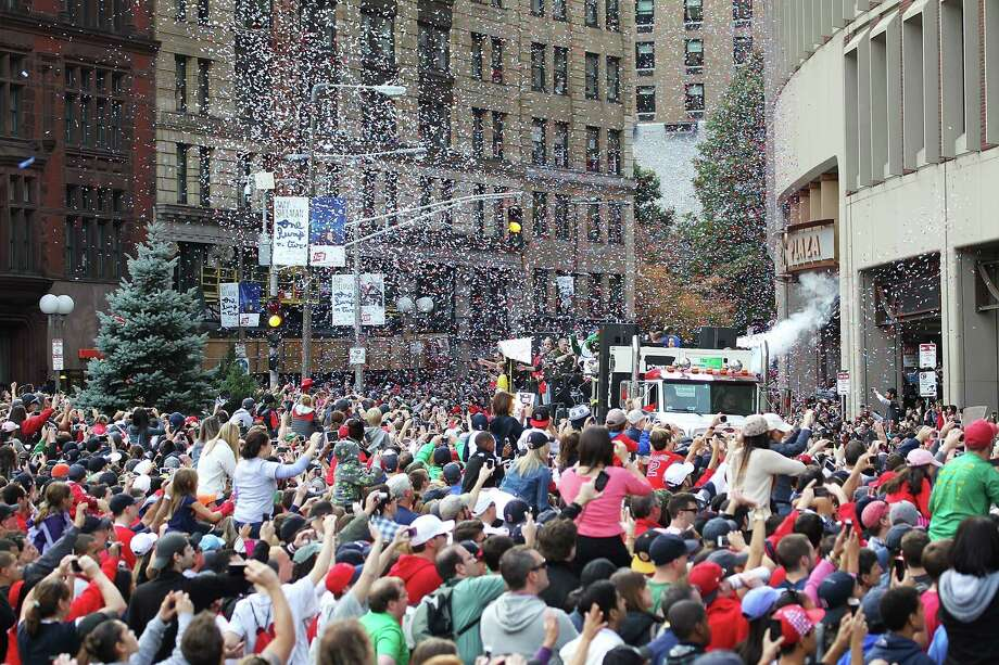 BOSTON, MA - NOVEMBER 2:  The crowd at Boston City Hall Plaza cheers as the duck boats make their way down Tremont Street during the World Series victory parade for the Boston Red Sox on November 2, 2013 in Boston, Massachusetts. Photo: Gail Oskin, Getty Images / Getty Images