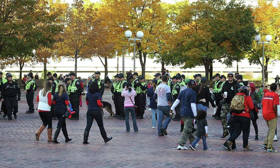 BOSTON, MA - NOVEMBER 2:  Police presence was evident at Boston City Hall Plaza as the duck boats maked their way down Tremont Street during the World Series victory parade for the Boston Red Sox on November 2, 2013 in Boston, Massachusetts. Photo: Gail Oskin, Getty Images / Getty Images