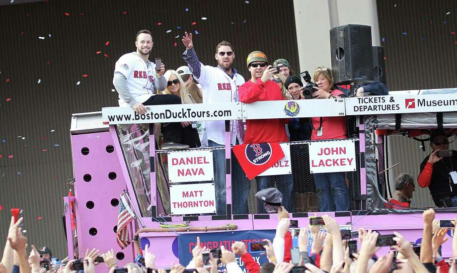 BOSTON, MA - NOVEMBER 2:  Daniel Nava, John Lackey wave to the crowd on one of the duck boats as they make their way down Tremont Street where fans gathered for the World Series victory parade for the Boston Red Sox on November 2, 2013 in Boston, Massachusetts. Photo: Gail Oskin, Getty Images / Getty Images