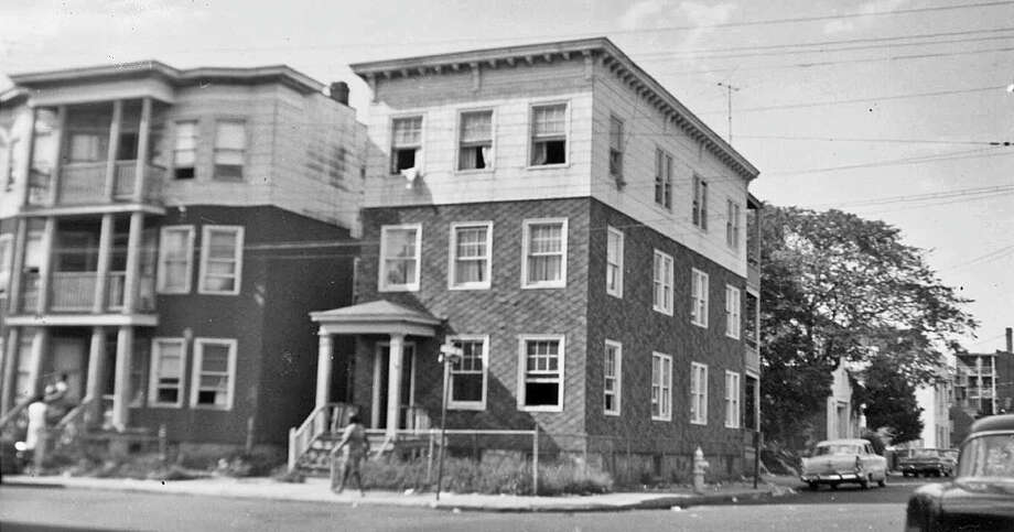 Jimmy Sparrow grew up in a cold-water railroad flat on the third floor of the apartment building to the left in this photo from about 1960. The address , 34 Brook St., now is Tresser Boulevard, across from the Stamford Marriott.  It was one of many apartment buildings razed for a downtown renewal that never happened for that parcel, which came to be known as the hole in the ground. Photo: Contributed Photo / Stamford Advocate Contributed