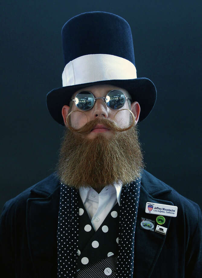 Jeffrey Moustache of the U.S. poses before taking part in the Beard World Championship 2013 in Leinfelden-Echterdingen near Stuttgart November 2, 2013. More than 300 people from around the world compete in different mustache and beard categories. Photo: © Michaela Rehle / Reuters, Reuters / X01425