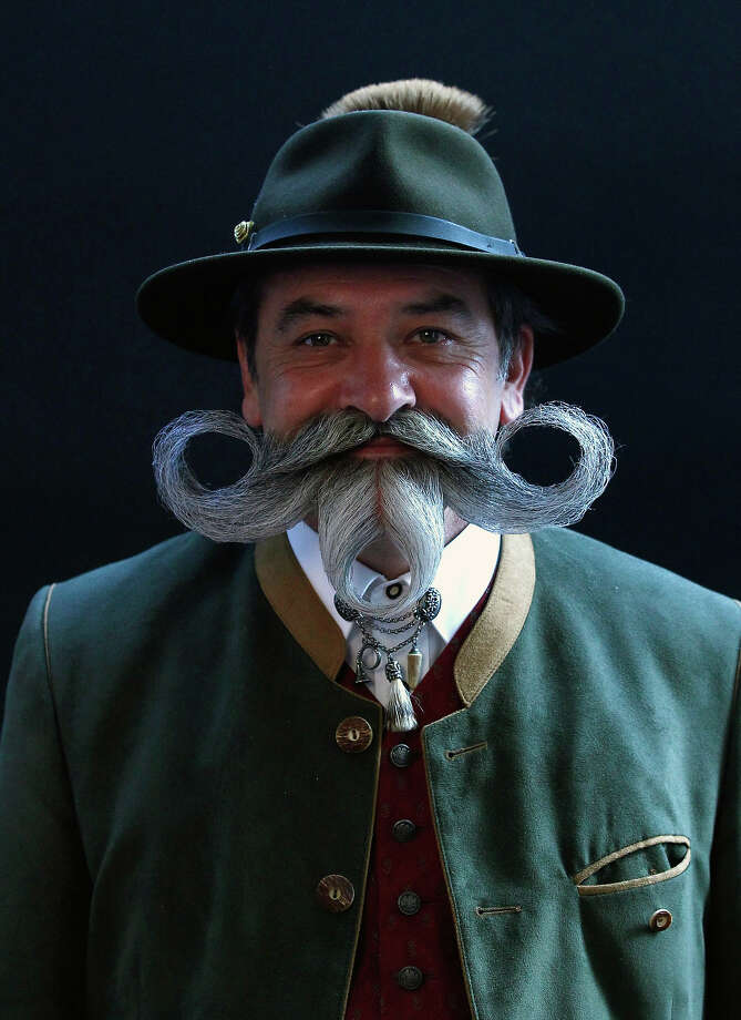 Norbert Topf from Austria poses before taking part in the Beard World Championship 2013 in Leinfelden-Echterdingen near Stuttgart November 2, 2013. More than 300 people from around the world compete in different mustache and beard categories. Photo: © Michaela Rehle / Reuters, Reuters / X01425