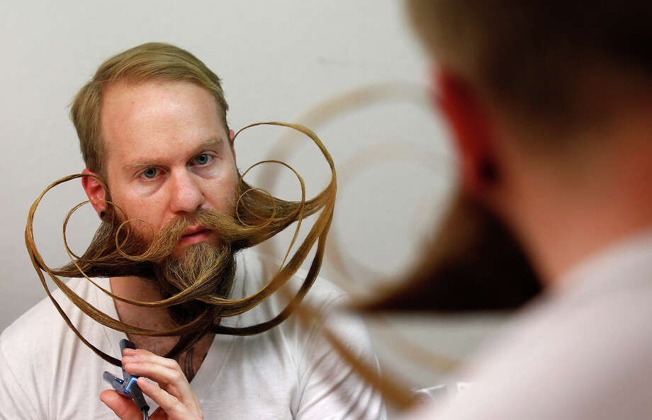 Participant Justin Kellermeier of the U.S. styles his beard for the Beard World Championship 2013 in Leinfelden-Echterdingen near Stuttgart November 2, 2013. Kellermeier needs more than 5 hours for his beard art work. More than 300 people from around the world compete in different mustache and beard categories. Photo: © Michaela Rehle / Reuters, Reuters / X01425