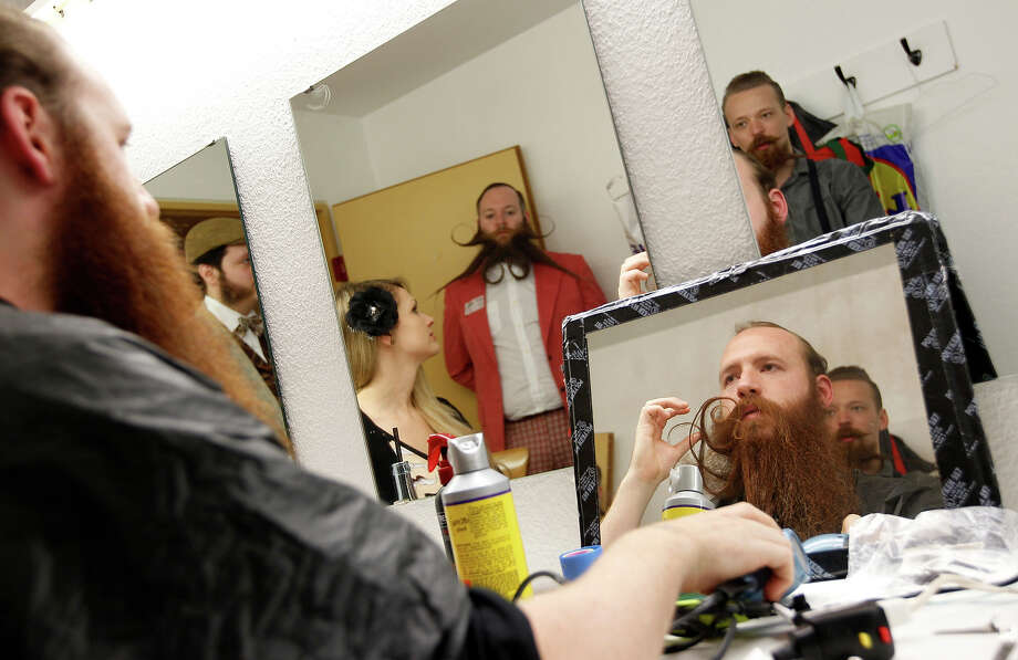 Participants style their beards for the Beard World Championship 2013 in Leinfelden-Echterdingen near Stuttgart November 2, 2013. More than 300 people from around the world compete in different mustache and beard categories. Photo: © Michaela Rehle / Reuters, Reuters / X01425