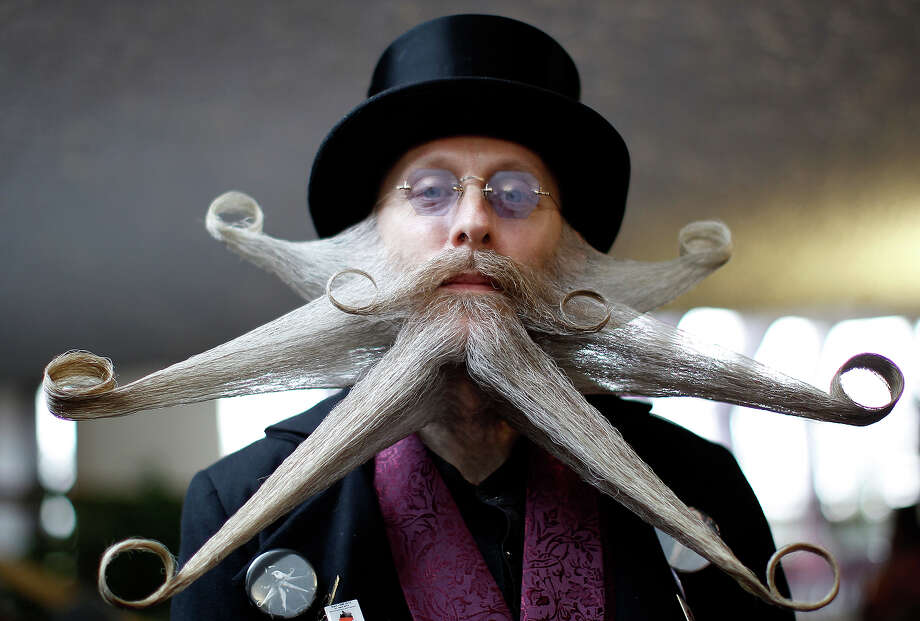 Armin Bielefeldt of the U.S. poses with his beard art work before the Beard World Championship 2013 in Leinfelden-Echterdingen near Stuttgart November 2, 2013. Bielefeldt needs more than 6 hours for his art work. More than 300 people from around the world compete in different mustache and beard categories. Photo: © Michaela Rehle / Reuters, Reuters / X01425