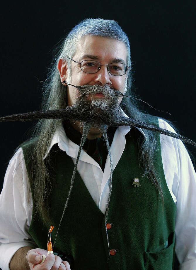 Charlie Savill of Britain poses before taking part in the Beard World Championship 2013 in Leinfelden-Echterdingen near Stuttgart November 2, 2013. More than 300 people from around the world compete in different mustache and beard categories. Photo: © Michaela Rehle / Reuters, Reuters / X01425