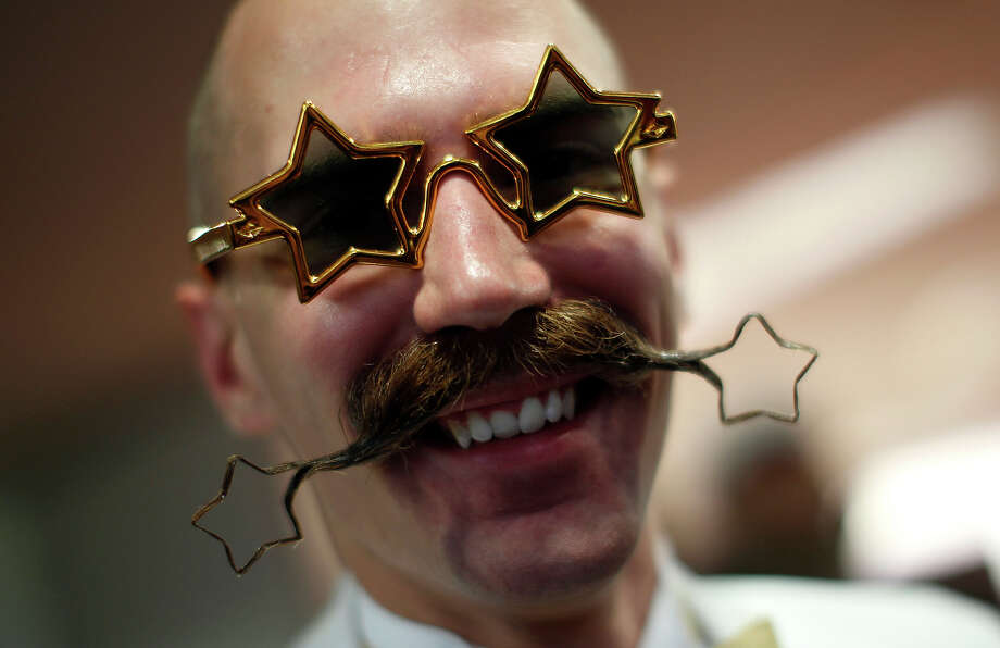 Daniel Lablor of the U.S. poses with his beard art work before the Beard World Championship 2013 in Leinfelden-Echterdingen near Stuttgart November 2, 2013. More than 300 people from around the world compete in different mustache and beard categories. Photo: © Michaela Rehle / Reuters, Reuters / X01425