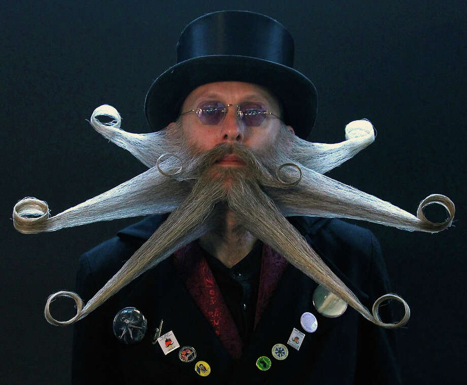 Armin Bielefeldt of the U.S. poses before taking part in the Beard World Championship 2013 in Leinfelden-Echterdingen near Stuttgart November 2, 2013. More than 300 people from around the world compete in different mustache and beard categories. Photo: © Michaela Rehle / Reuters, Reuters / X01425