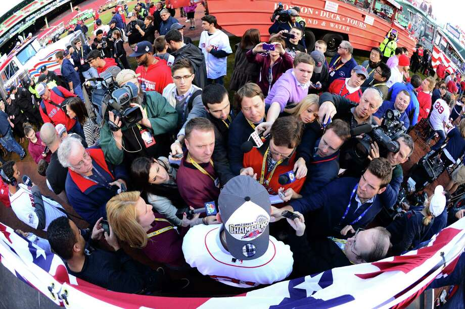 BOSTON, MA - NOVEMBER 2:  Media surrounds Jon Lester #31 of the Boston Red Sox before the start of a victory parade on November 2, 2013 at Fenway Park in Boston, Massachusetts. Photo: Michael Ivins/Boston Red Sox, Getty Images / Getty Images