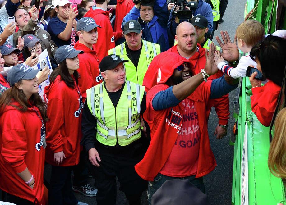 BOSTON, MA - NOVEMBER 2:  David Ortiz #34 of the Boston Red Sox waves to a fan during a victory parade on November 2, 2013 through Boston, Massachusetts. Photo: Michael Ivins/Boston Red Sox, Getty Images / Getty Images