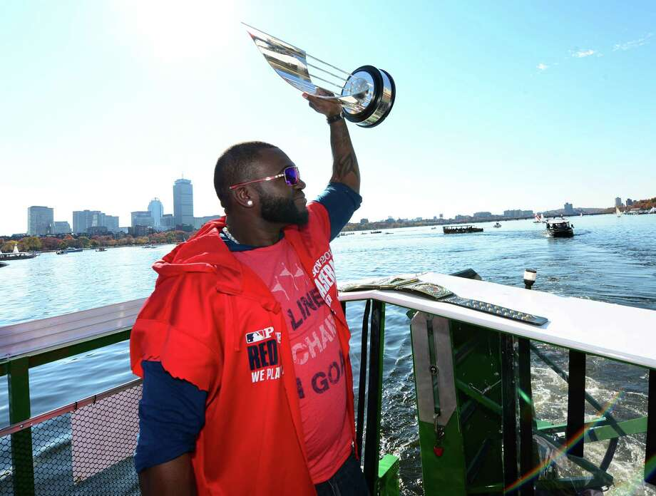 BOSTON, MA - NOVEMBER 2:  David Ortiz #34 of the Boston Red Sox holds up his World Series MVP trophy during a victory parade on November 2, 2013 through Boston, Massachusetts. Photo: Michael Ivins/Boston Red Sox, Getty Images / Getty Images