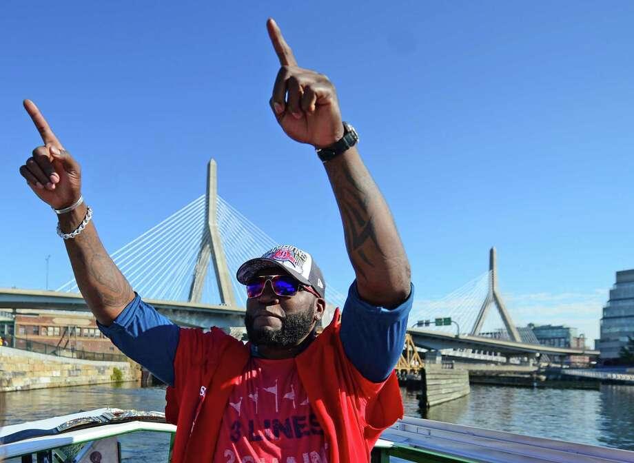 BOSTON, MA - NOVEMBER 2:  David Ortiz #34 of the Boston Red Sox waves to fans during a victory parade on November 2, 2013 through Boston, Massachusetts. Photo: Michael Ivins/Boston Red Sox, Getty Images / Getty Images