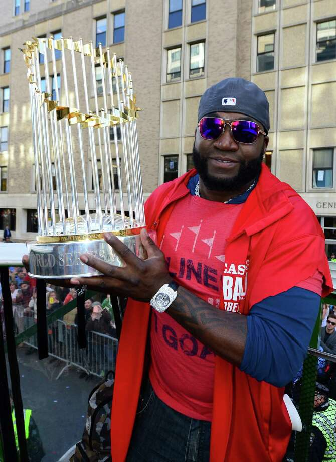BOSTON, MA - NOVEMBER 2:  David Ortiz #34 of the Boston Red Sox holds up the 2013 World Series trophy during a victory parade on November 2, 2013 through Boston, Massachusetts. Photo: Michael Ivins/Boston Red Sox, Getty Images / Getty Images