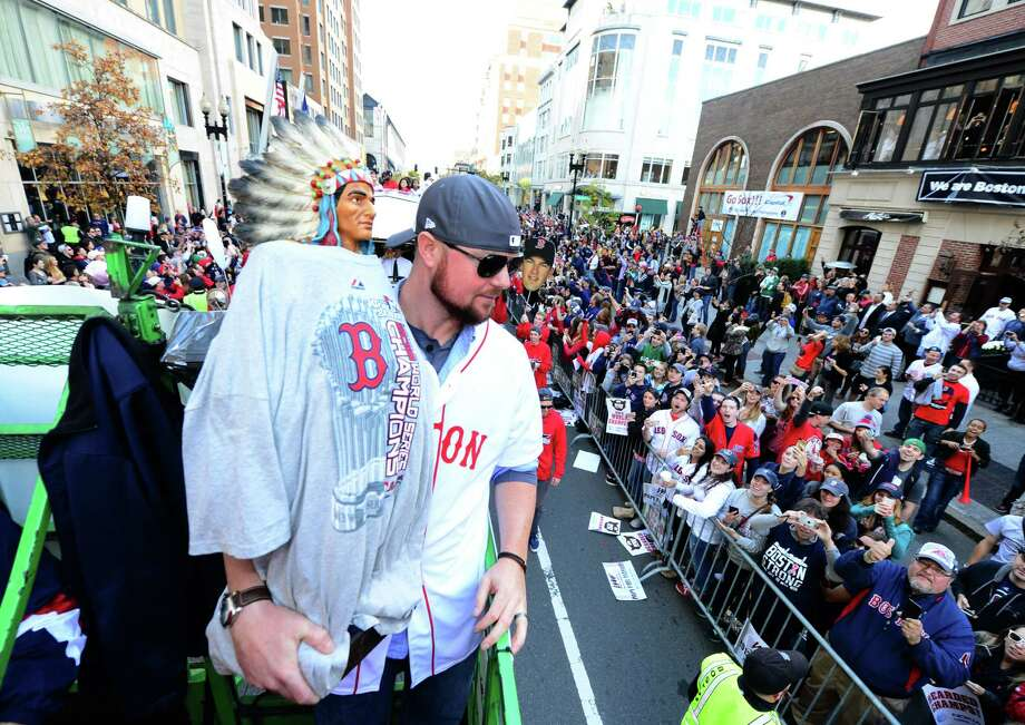 "BOSTON, MA - NOVEMBER 2:  Jon Lester #31 of the Boston Red Sox holds up ""Chief"", a Native American statue that became an unofficial clubhouse mascot,  during a victory parade on November 2, 2013 through Boston, Massachusetts. Photo: Michael Ivins/Boston Red Sox, Getty Images / Getty Images"