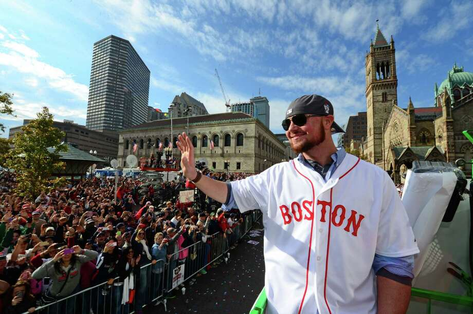 BOSTON, MA - NOVEMBER 2:  Jon Lester #31 of the Boston Red Sox waves to fans during a victory parade on November 2, 2013 through Boston, Massachusetts. Photo: Michael Ivins/Boston Red Sox, Getty Images / Getty Images