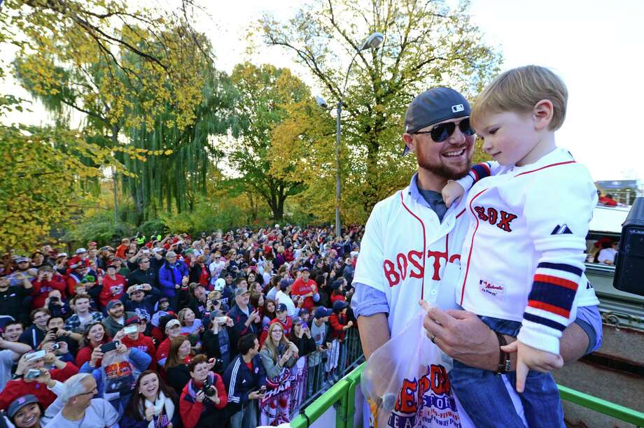BOSTON, MA - NOVEMBER 2:  Jon Lester #31 of the Boston Red Sox enjoys a victory parade with his son Hudson on November 2, 2013 through Boston, Massachusetts. Photo: Michael Ivins/Boston Red Sox, Getty Images / Getty Images