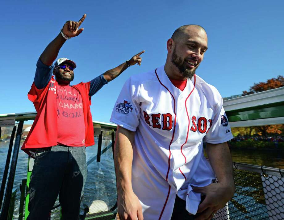 BOSTON, MA - NOVEMBER 2:  Shane Victorino #18 and David Ortiz #34 of the Boston Red Sox react to the crowd on the banks of the Charles during the river portion of a victory parade on November 2, 2013 through Boston, Massachusetts. Photo: Michael Ivins/Boston Red Sox, Getty Images / Getty Images