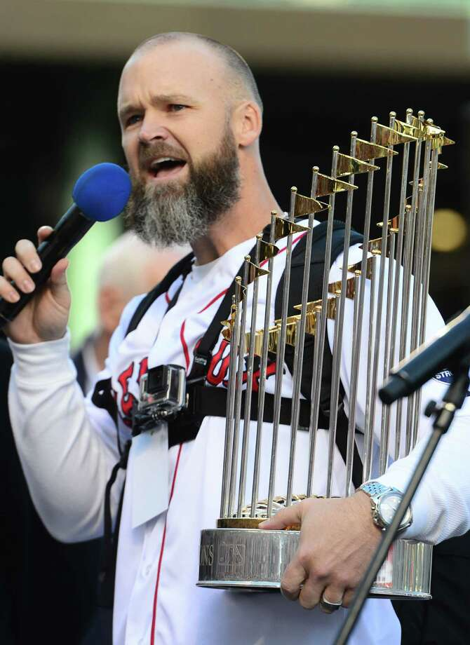 BOSTON, MA - NOVEMBER 2:  David Ross #3 of the Boston Red Sox addresses a crowd while holding the 2013 World Series trophy before the start of a victory parade on November 2, 2013 at Fenway Park in Boston, Massachusetts. Photo: Michael Ivins/Boston Red Sox, Getty Images / Getty Images