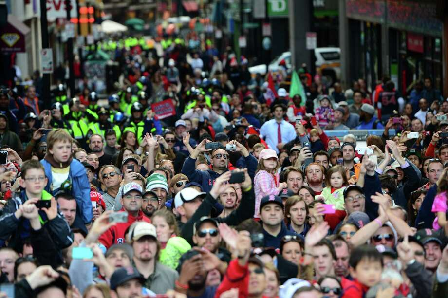 BOSTON, MA - NOVEMBER 2:  Fans crowd the parade route during a Boston Red Sox victory parade on November 2, 2013 in Boston, Massachusetts. Photo: Michael Ivins/Boston Red Sox, Getty Images / Getty Images