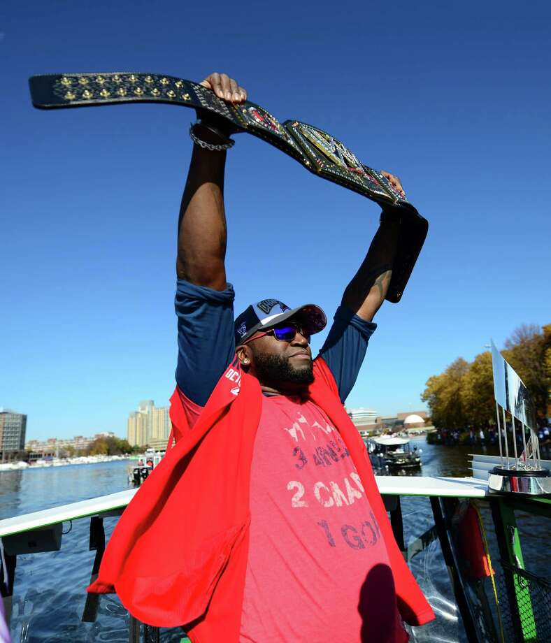 BOSTON, MA - NOVEMBER 2:  David Ortiz #34 of the Boston Red Sox holds a WWE Championship Belt that was sent to him by John Cena  during the river portion of a victory parade on November 2, 2013 through Boston, Massachusetts. Photo: Michael Ivins/Boston Red Sox, Getty Images / Getty Images