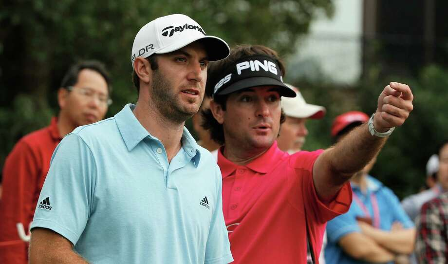 SHANGHAI, CHINA - NOVEMBER 02:  Dustin Johnson (L) and Bubba Watson of the USA try to determine where Dustin Johnson's tee shot entered the water hazard on the 18th hole during the third round of the WGC-HSBC Champions at the Sheshan International Golf Club on November 2, 2013 in Shanghai, China.  (Photo by Scott Halleran/Getty Images) ORG XMIT: 181933860 Photo: Scott Halleran / 2013 Getty Images