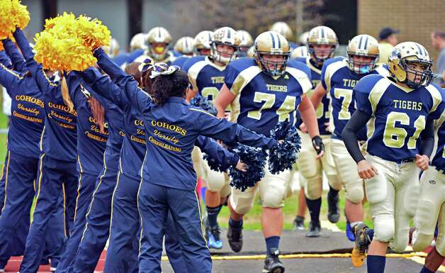 Cohoes cheerleaders as their team takes the field against Broadalbin-Perthin their Class B semifinal game Saturday Nov. 2, 2013, in Cohoes, NY.  (John Carl D'Annibale / Times Union) Photo: John Carl D'Annibale / 00024471A