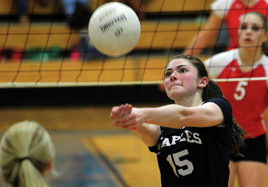 Staples' Ariana Sherman bumps the ball over to Greenwich, during FCIAC Girls' Volleyball Championship action at Fairfield Ludlowe High School in Fairfield, Conn. on Saturday November 2, 2013. Photo: Christian Abraham / Connecticut Post