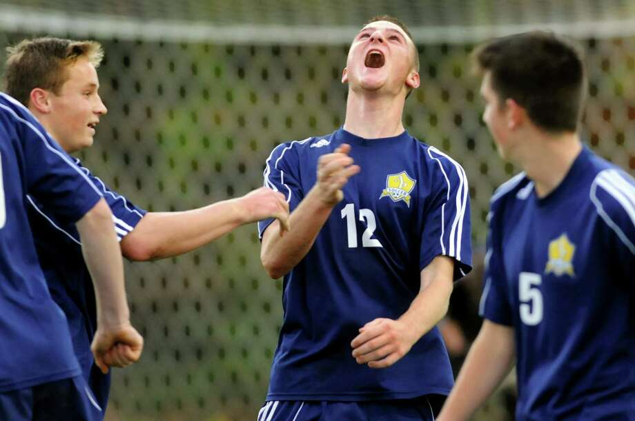 Averill Park's Owen Nuss, center, lets out a roar after scoring in the second half of their Section II Class A soccer championship game against South Glens Falls on Saturday, Nov. 2, 2013, at Colonie High in Colonie, N.Y. (Cindy Schultz / Times Union) Photo: Cindy Schultz / 00024490A