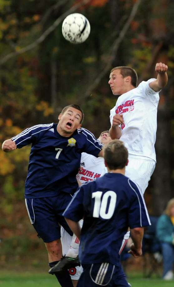 Averill Park's Mac Hoyt, left, and South Glens Falls' Darren Greenwood, right, compete for the header during their Section II Class A soccer championship game on Saturday, Nov. 2, 2013, at Colonie High in Colonie, N.Y. (Cindy Schultz / Times Union) Photo: Cindy Schultz / 00024490A