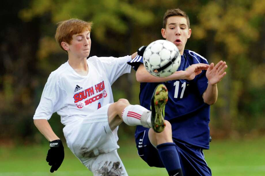 South Glens Falls' Teddy Bruschini, left, and Averill Park's Matt Ketzer battle for the ball during their Section II Class A soccer championship game on Saturday, Nov. 2, 2013, at Colonie High in Colonie, N.Y. (Cindy Schultz / Times Union) Photo: Cindy Schultz / 00024490A