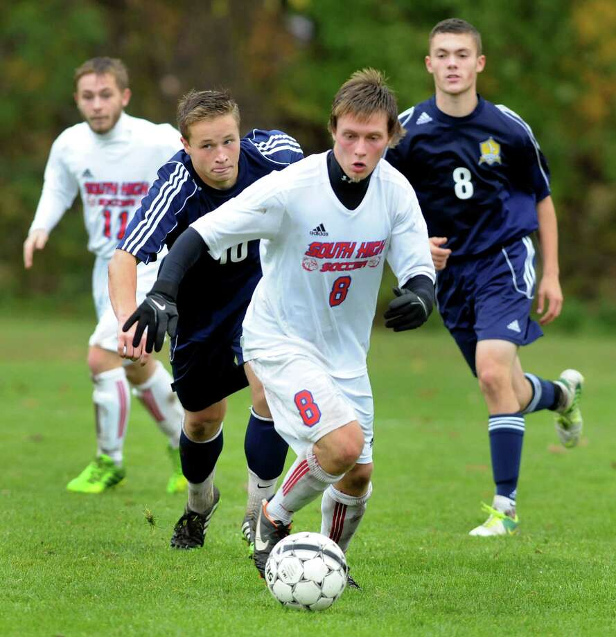 South Glens Falls' Kyle Ogden, center, controls the ball as Averill Park's Josh Lionarons, second from left, and Ben Reinisch, right, give chase during their Section II Class A soccer championship game on Saturday, Nov. 2, 2013, at Colonie High in Colonie, N.Y. (Cindy Schultz / Times Union) Photo: Cindy Schultz / 00024490A
