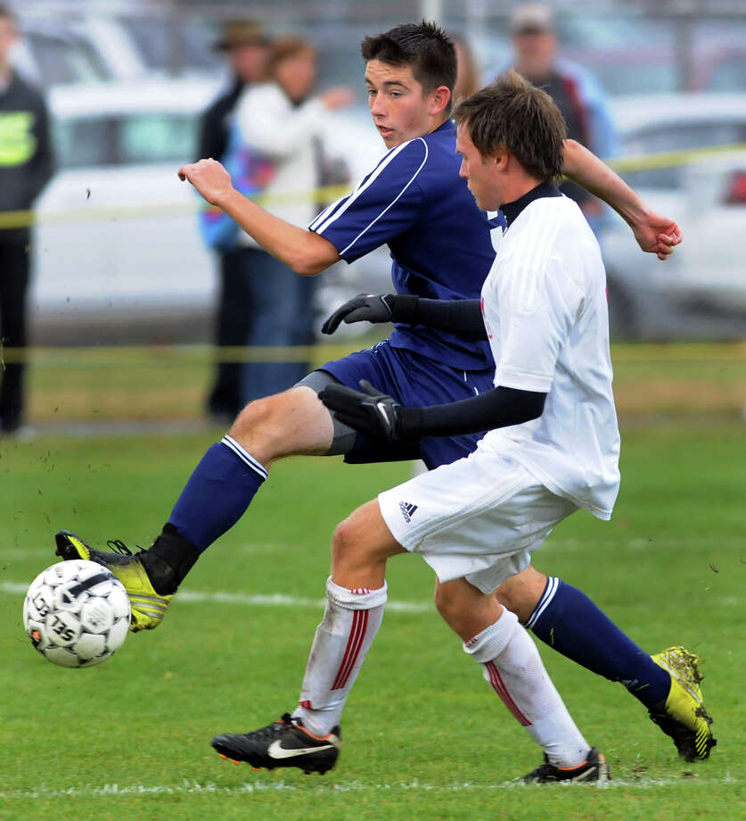 Averill Park's Alex Miller, left, controls the ball as South Glens Falls' Kyle Ogden defends during their Section II Class A soccer championship game on Saturday, Nov. 2, 2013, at Colonie High in Colonie, N.Y. (Cindy Schultz / Times Union) Photo: Cindy Schultz / 00024490A
