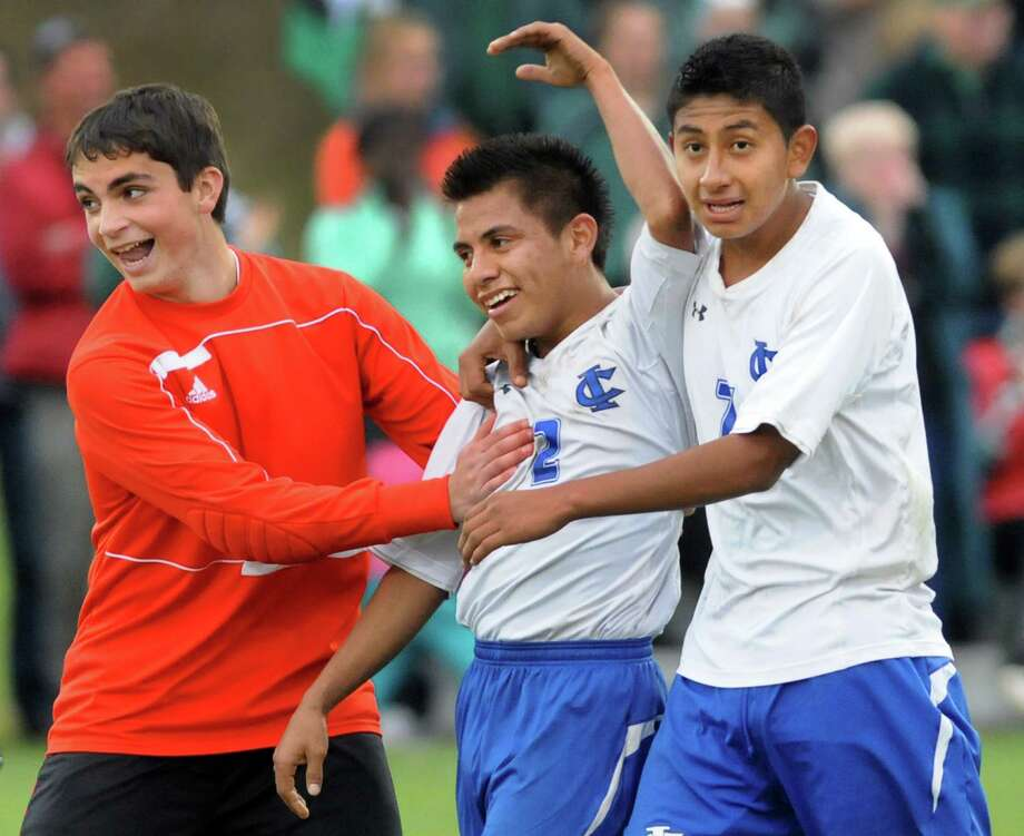 Ichabod Crane's Diego Lezama, center, celebrates with teammates when they win their Section II Class B soccer championship game over Schalmont on Saturday, Nov. 2, 2013, at Colonie High in Colonie, N.Y. Lezama scored the winning goal. (Cindy Schultz / Times Union) Photo: Cindy Schultz / 00024490A