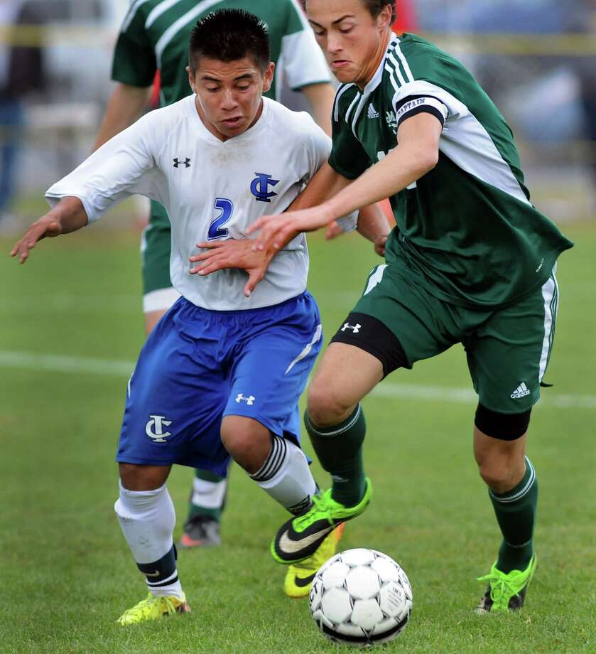 Ichabod Crane's Diego Lezama, left, and Schalmont's Gino Rossi battle for the ball during their Section II Class B soccer championship game on Saturday, Nov. 2, 2013, at Colonie High in Colonie, N.Y. (Cindy Schultz / Times Union) Photo: Cindy Schultz / 00024490A