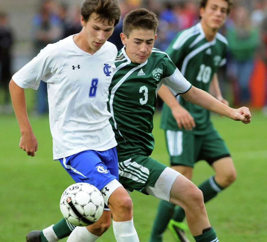 Ichabod Crane's Seth Scarano, left, and Schalmont's Chis Hamilton, center, battle for the ball during their Section II Class B soccer championship game on Saturday, Nov. 2, 2013, at Colonie High in Colonie, N.Y. (Cindy Schultz / Times Union) Photo: Cindy Schultz / 00024490A