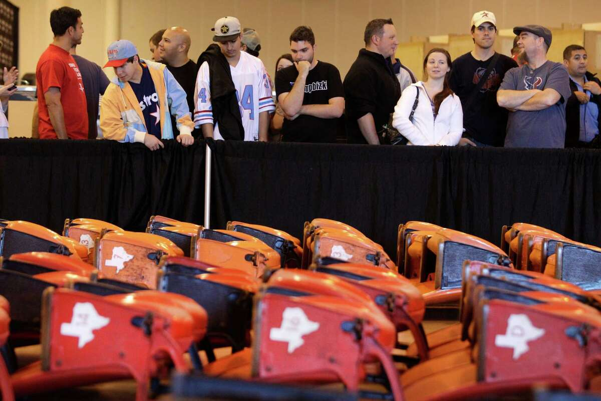 People wait in line at Reliant Center to buy seats during the auction and sale of Astrodome items Saturday in Houston.