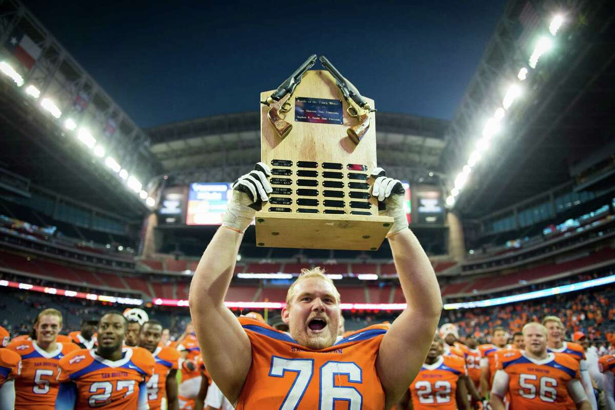 Sam Houston State offensive linesman Matt Boyles celebrates after the Bearkats defeated Stephen F. Austin to claim the annual Battle of the Piney Woods at Reliant Stadium, Saturday, Nov. 2, 2013, in Houston. SHSU won the game 56-49.