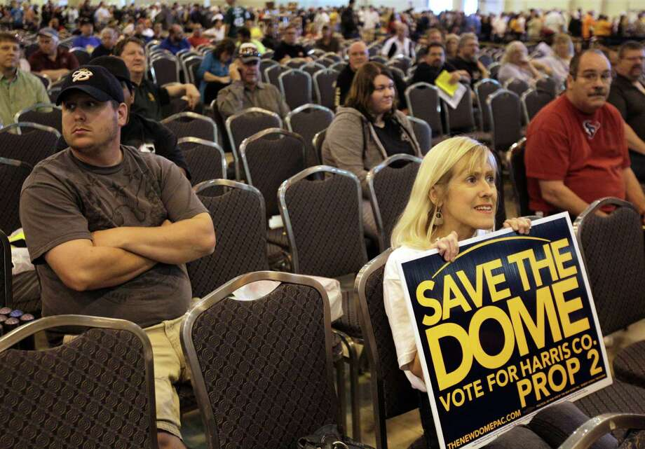 Regina Seale holds a Save the Dome Vote Prop 2 sign during the auction of Astrodome items at Reliant Center Saturday, Nov. 2, 2013, in Houston. Photo: Melissa Phillip, Houston Chronicle / © 2013  Houston Chronicle