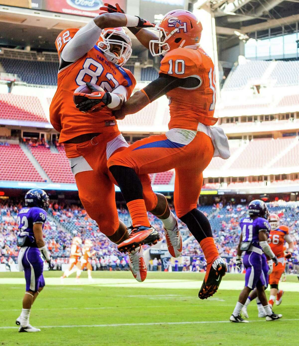 Sam Houston State wide receiver Stephen Williams (82) celebrates with teammate Torrance Williams (10) after scoring on a touchdown reception in the first half.