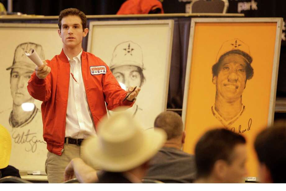 Auction bid catcher Logan Thomas works the crowd during auction of Astrodome items at Reliant Center Saturday, Nov. 2, 2013, in Houston. Photo: Melissa Phillip, Houston Chronicle / © 2013  Houston Chronicle